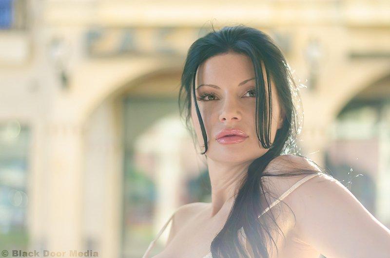 Closeup photo of Stephanie outside of Tivoli Village by Black Door Media