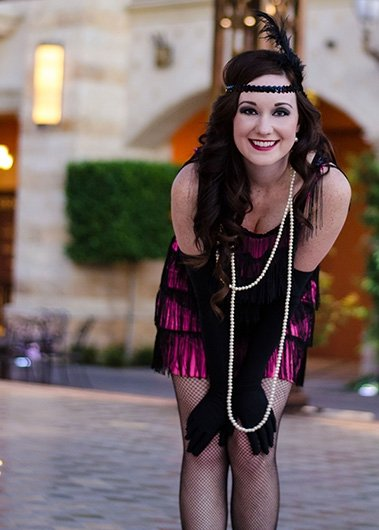 Jenny taking a moment to smile at the camera during our 1920s photo shoot with Black Door Media