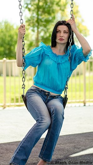 Full body shot of Stephanie on the swings by Black Door Media