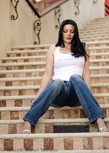Stephanie rocking a tank top and jeans on the steps of Tivoli Village with Black Door Media