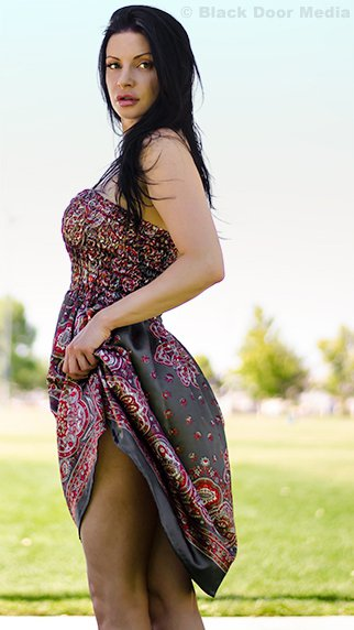 Stephanie looking over her shoulder during a photoshoot at Desert Breeze Park with Black Door Media