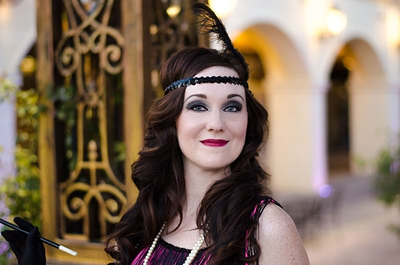 Jenny playing a flapper girl during a photoshoot with Black Door Media
