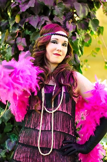 Jenny with her boa feathers for a flapper girl photo shoot with Black Door Media